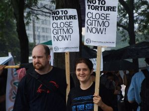 Two protesters, photo by Joshua Sherurcij