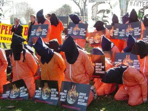 Participants in a rally sponsored by The World Can't Wait are dressed as hooded detainees on January 4, 2007. Photo by Ben Schumin.
